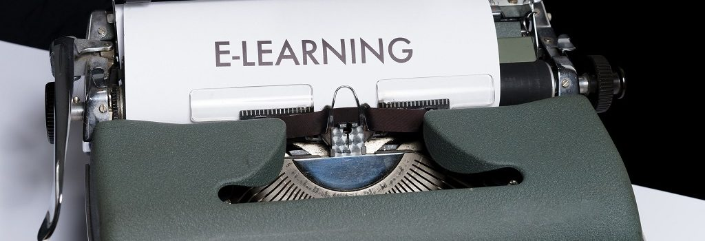 "Typing machine and ""E-learning"" written on it."