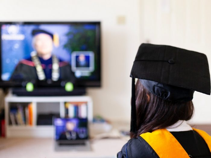 Girl who is a student watching a graduation ceremony.